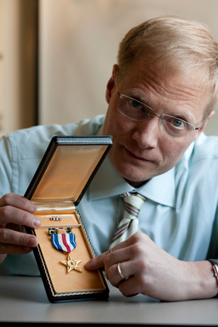 Brian Wansink with a World War II medal.