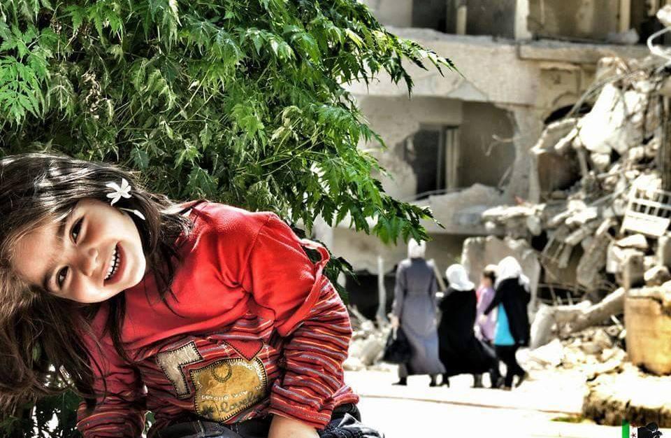 CCA girl in rubble