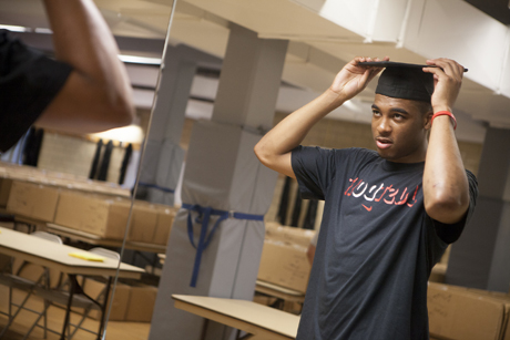 student tries on cap