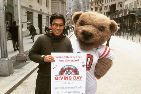 Big Red Bear with alumnus on Wall Street