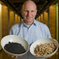 Johannes Lehmann holds bowls of biomass and biochar