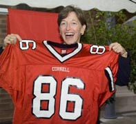 Susan Murphy proudly shows off the Big Red football jersey