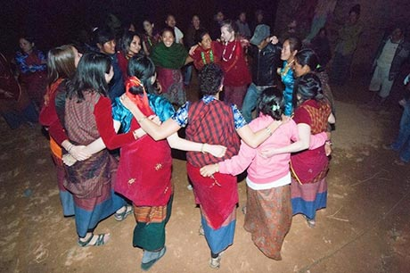 Students dance with Nepalese villagers