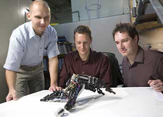 researchers with robot