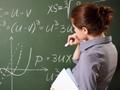 Woman at chalkboard