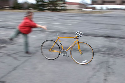 pushing a bicycle