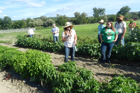 symposium participants tour farm