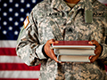 Veterans holding books