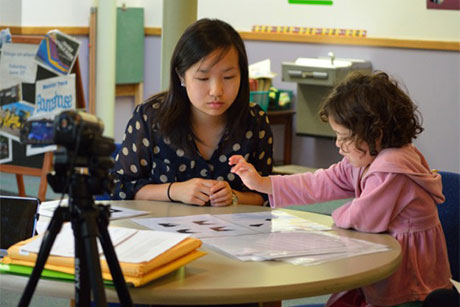 Wendy Wei leads a child through spatial cognition tests