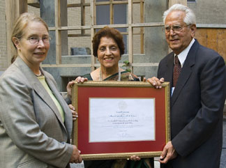 presents Nandlal P. Tolani, right, and Papu Tolani with a certificate to honor