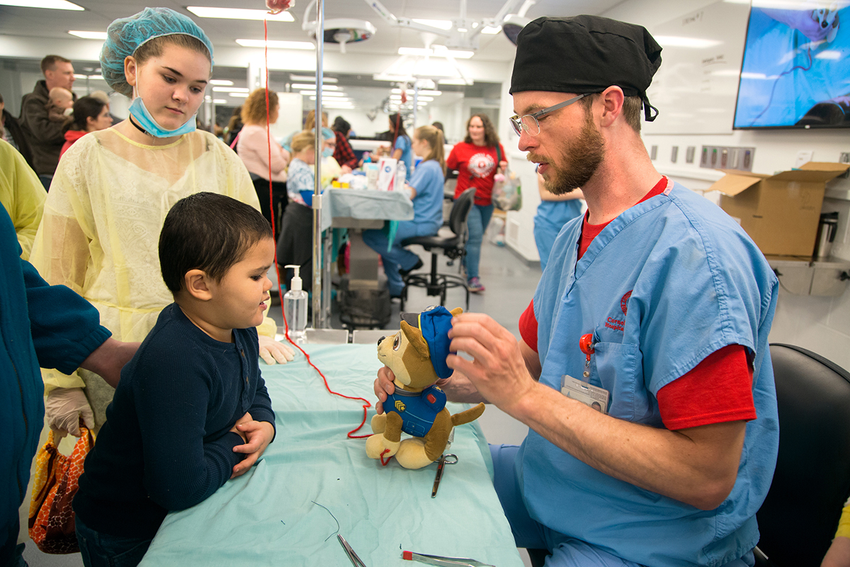 Trey Phillips, 4, looks on as his police dog, Chase, comes out of surgery during the College of Veterinary Medicine's open house, April 1.