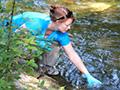 Kristy Deiner samples the water