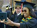 graduates take an iPad selfie