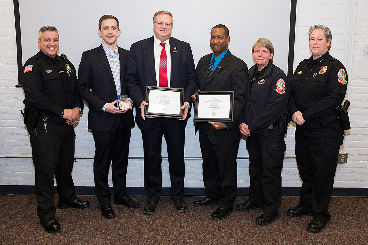 police officers and veteran recognized for life saving actions