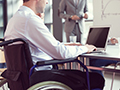 Man in wheelchair at computer