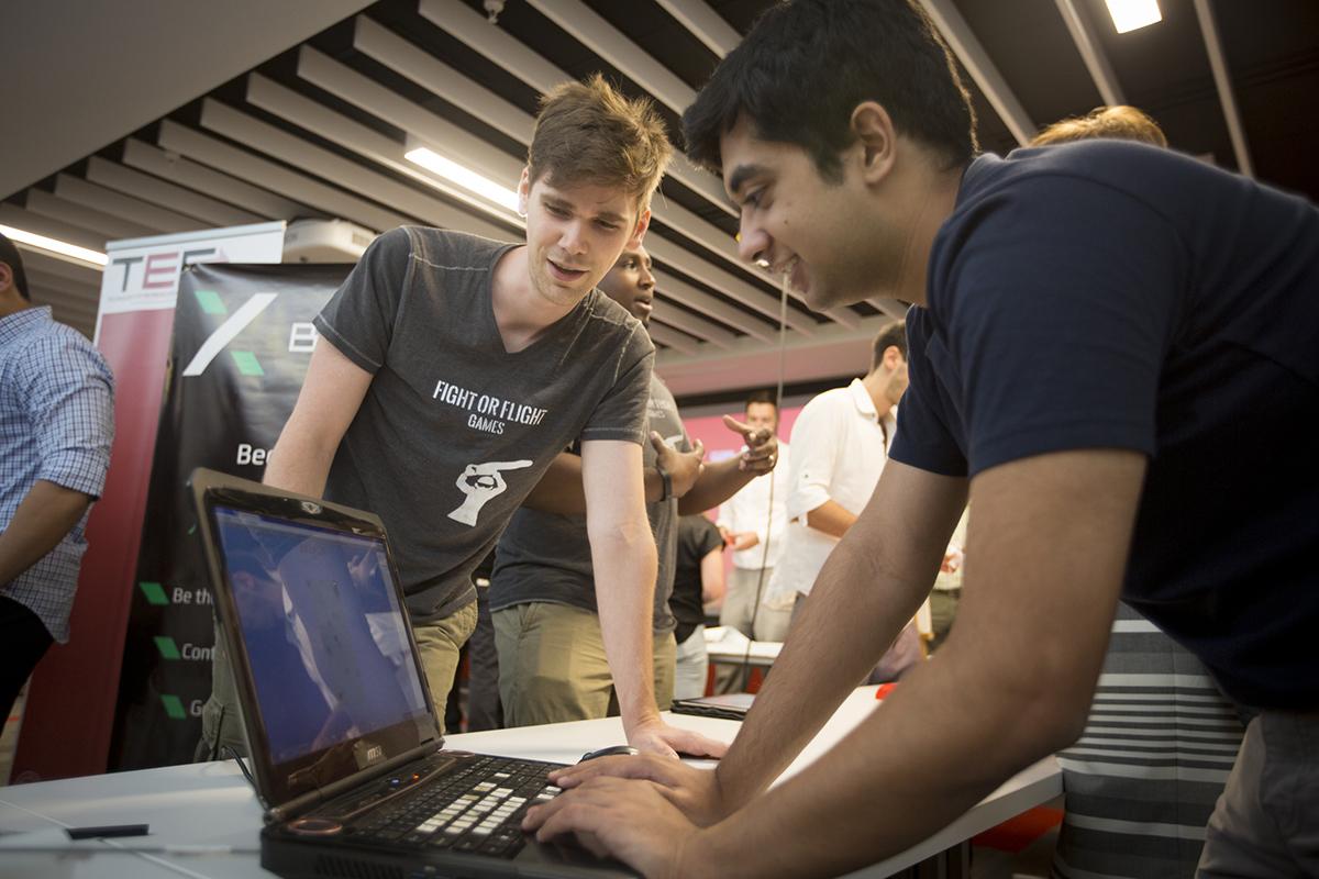 eShip pair looks at computer