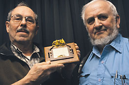 Professors hold gold specimen