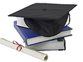 mortarboard and books