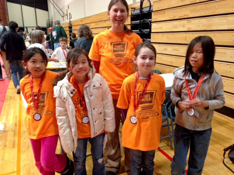Robin Bjorkquist with some of the girls from the Robot Masters LEGO team