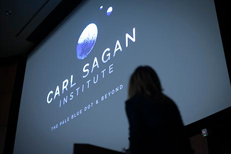 Ann Druyan in silhouette at Sagan ceremony