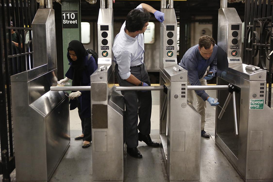 swabbing subway turnstile