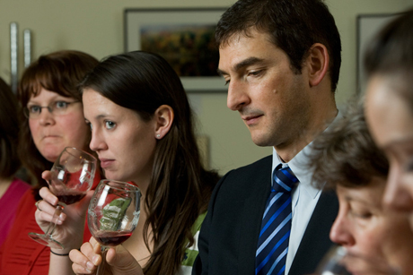 people tasting wine