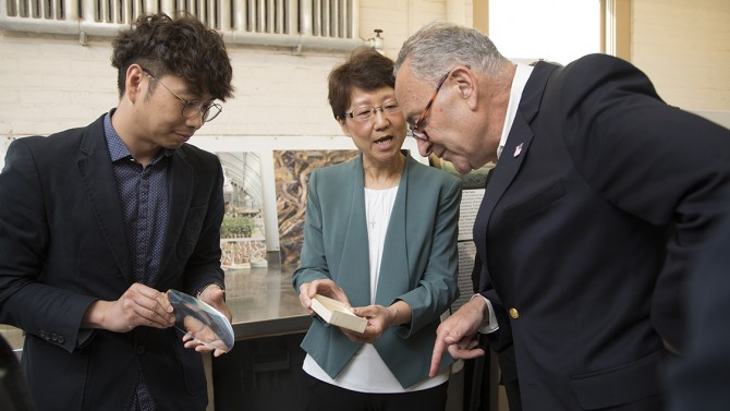 Senator Chuck Schumer chats with Jaebum Park and Xiaohong Wang during visit