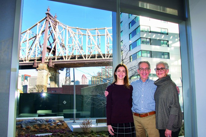 From right, Ellen and Mark, along with their daughter, Jill Wurzel '02, make a stop in the conference room during a tour of the center in Februar