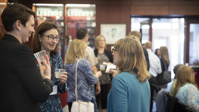 Staff graduates network at the 22nd annual Staff Graduate Reception May 16.