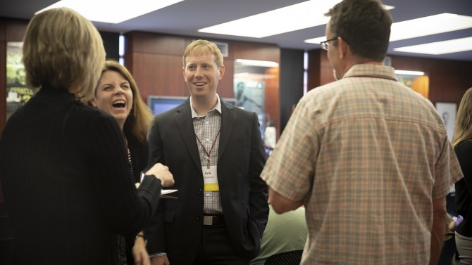 Erik Eshelman networks with other staff graduates at the 22nd annual Staff Graduate Reception May 16