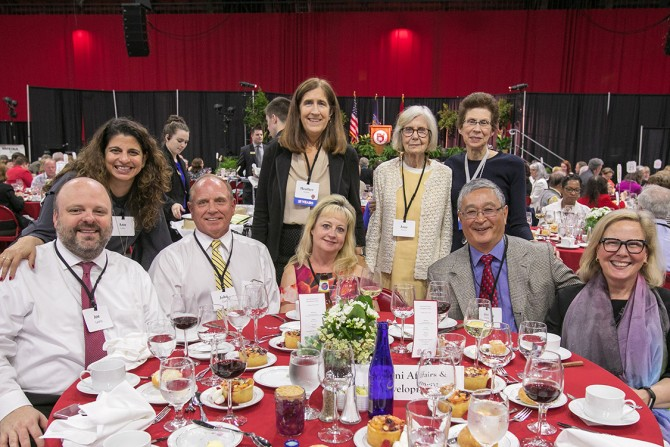 Staff members from Alumni Affairs and Development and guests celebrate at the 63rd Service Recognition Dinner June 5.