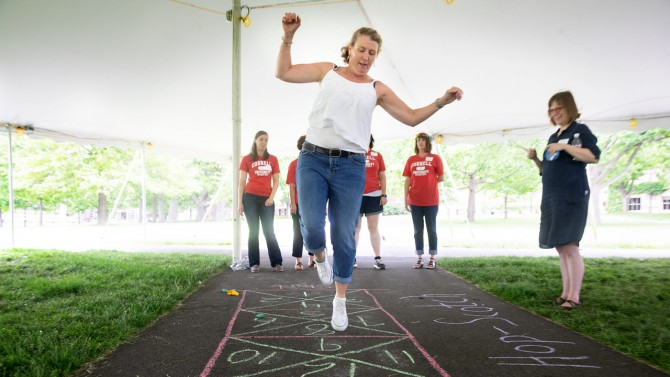 Staffers participated in games popular in the '60s: a hula-hoop contest, badminton, dart toss and hopscotch.