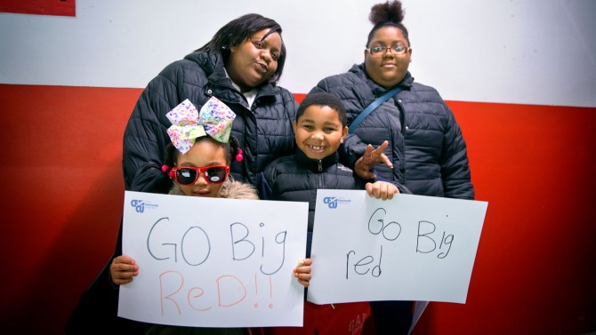 Jamicka and Janiya Prowell bring their children to women's ice hockey.