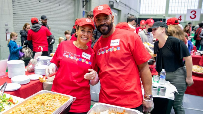 Victoria and Reginald White serve up chicken parmesan and pasta at the 2019 Winter Employee Celebration Feb. 16.