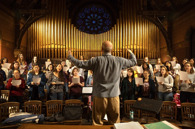 Members of the Cornell University Chorus sing during rehearsal