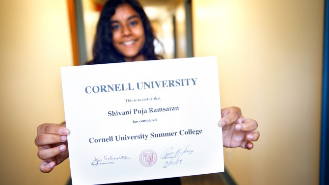 Student Holding up a Certificate