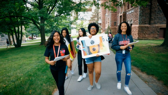Students with Art Walking on Campus