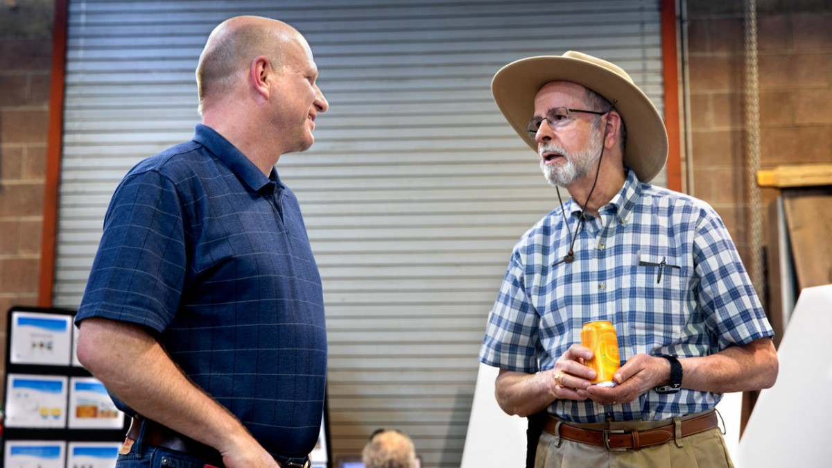 At the open house May 24, Johannes Lehmann, left, speaks with Frank DiSalvo, the retired director of the Atkinson Center for a Sustainable Future.