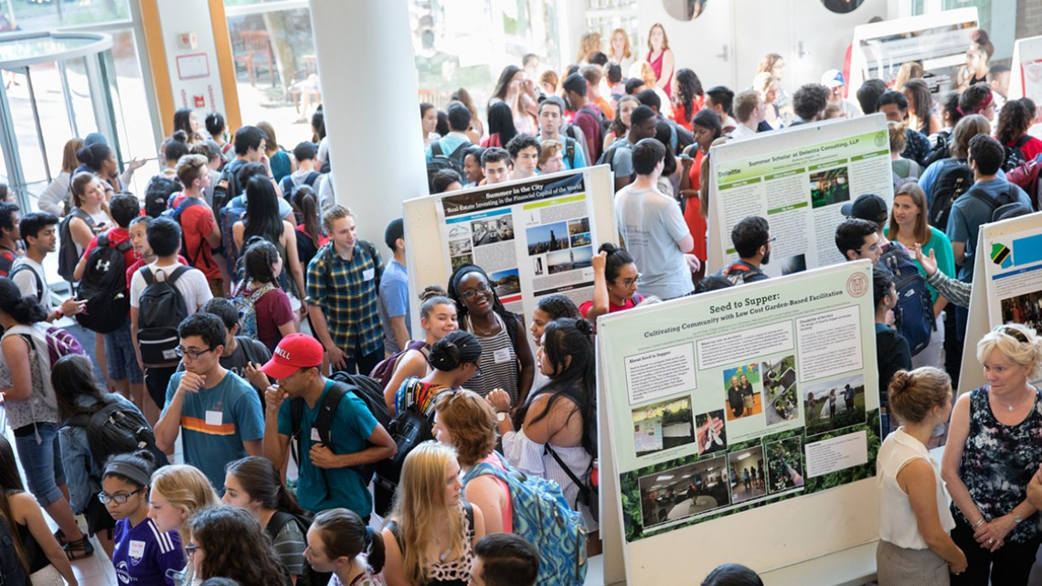 Several hundred students gathered at the Cornell Commitment event Sept. 27 to view posters and hear panel discussions on how student scholars spent their summer.
