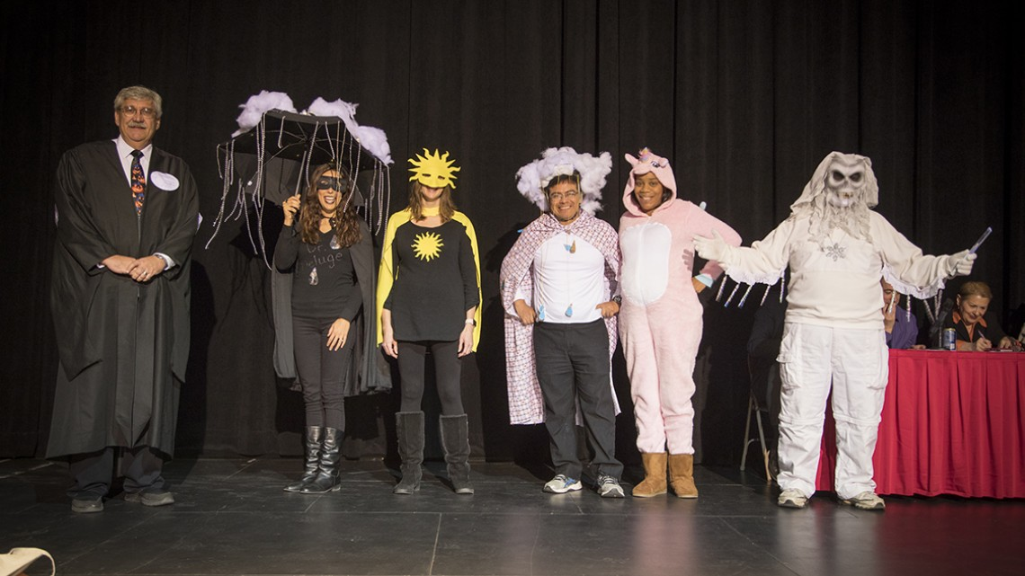 "Earth and Atmospheric Sciences staff, dressed as ""Weather Super Heroes and Villains,"" won ""judges' choice"""