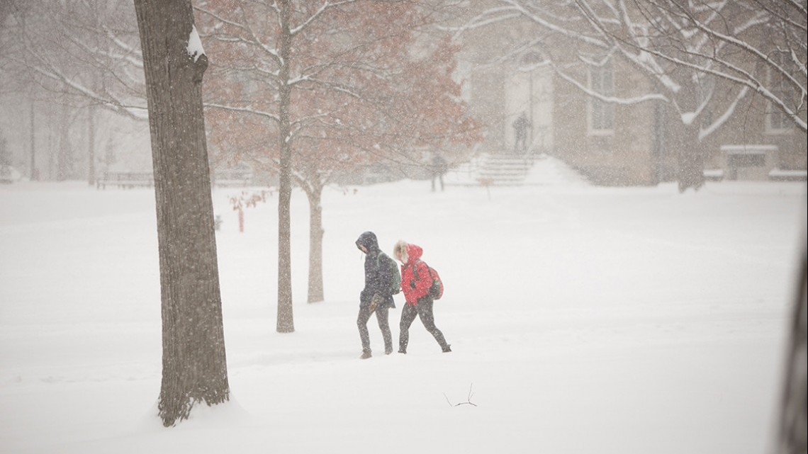 Students walk through the Arts Quad during a winter storm in March 2017 that closed Cornell.