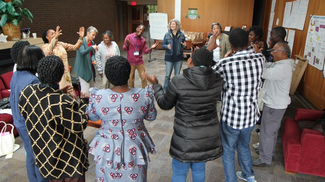Jonathan Miller Participants from India, Malawi, Tanzania, Canada and the United States dance at the wrap-up session of the Ecological Learning Collaboratory.
