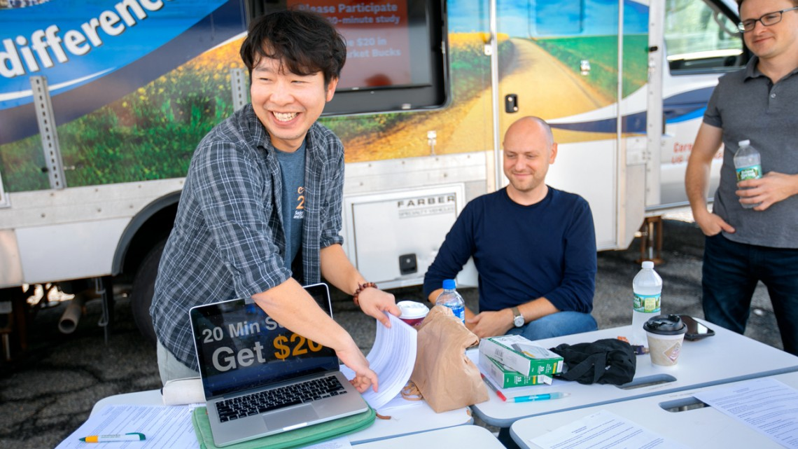 Jesse Winter Photography Graduate student Byungdoo Kim, left, greets study participants outside the lab. Looking on are Jonathon Schuldt �04, center, associate professor of communication, and Adam Pearson �03 of Pomona College, both researchers on the project.