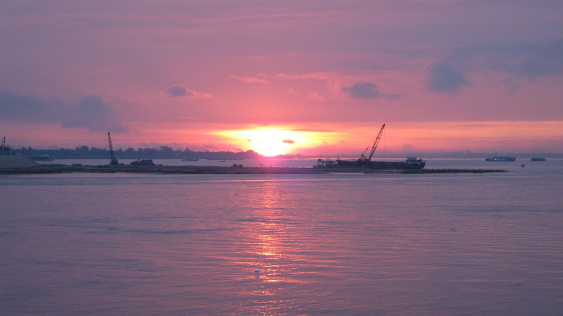 Provided Sunrise over the Mekong River in Phnom Penh, Cambodia, downstream of the Sambor Dam site.