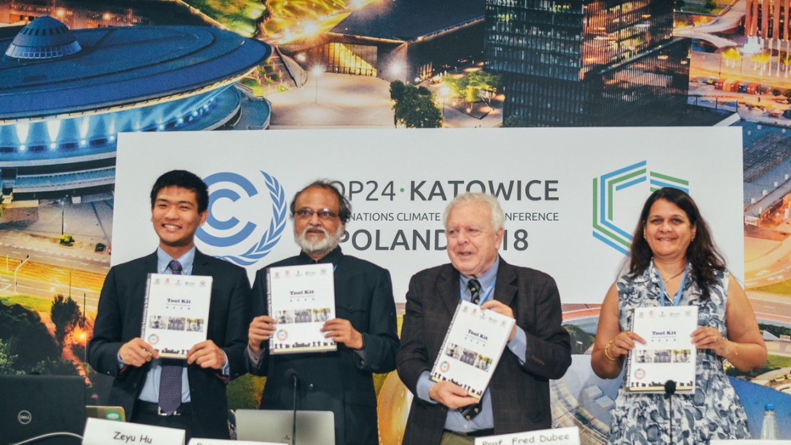 Maeve Anderson/Provided - From left, Cornell student Zeyu Hu; Rajendra Shende, of the TERRE Policy Center, India; Frederick Dubee, of the Beijing Genomics Institute; Vinita Apte of TERRE, unveil sustainability toolkits for institutions of higher education.