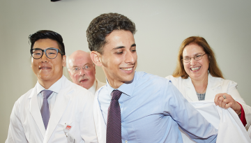 Weill students receive white coats