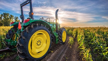 Tractor in corn field