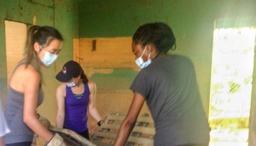 Elle Espinoza, Courtney Cheng, Alexis Pollitto and Ajara Cobourne clean out a Puerto Rican home ravaged by Hurricane Maria