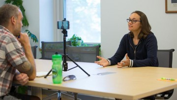 Priscilla Glen from the University of California at Davis takes part in a mock interview with Justin Cremer
