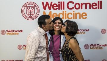 Nivita Sharma celebrates receiving her white coat alongside her parents